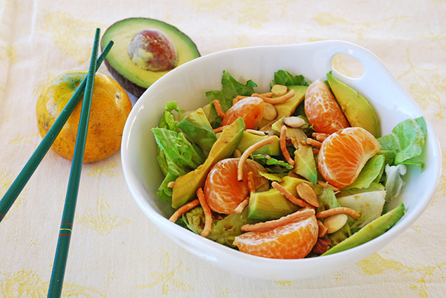 a fresh salad with avocado, Florida tangerines, and almonds