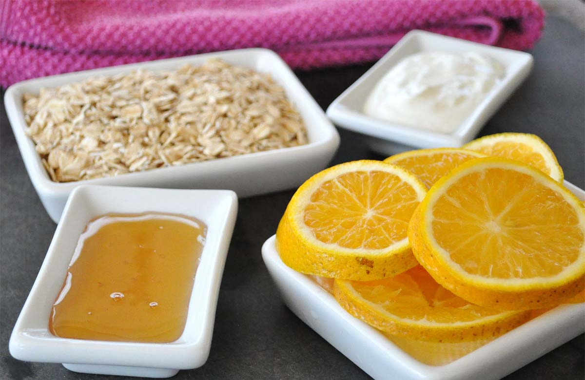 Citrus skincare mask for skin with that perfect glow: Citrus Honey Oat and Yogurt  mask ingredients with pink towel in background